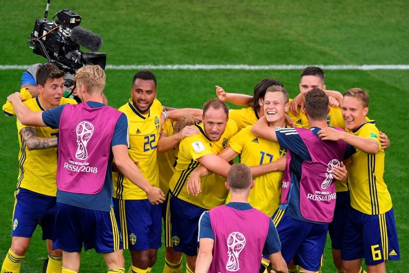 Sweden's players celebrate after the Russia 2018 World Cup Group F football match between Mexico and Sweden at the Ekaterinburg Arena in Ekaterinburg on June 27, 2018. (AFP Photo)