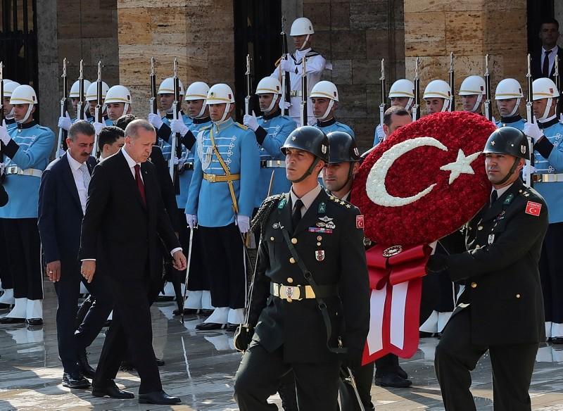 Erdoğan, left, walks for a wreath-laying ceremony at mausoleum of the nation's founding father Mustafa Kemal Atatürk, in Ankara,