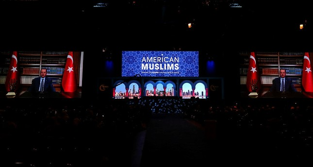 President Recep Tayyip Erdoğan addresses participants of the 16th Islamic Circle of North America-Muslim American Society Convention via a video message in Chicago, Ill., U.S., Dec. 30, 2017. (AA Photo)