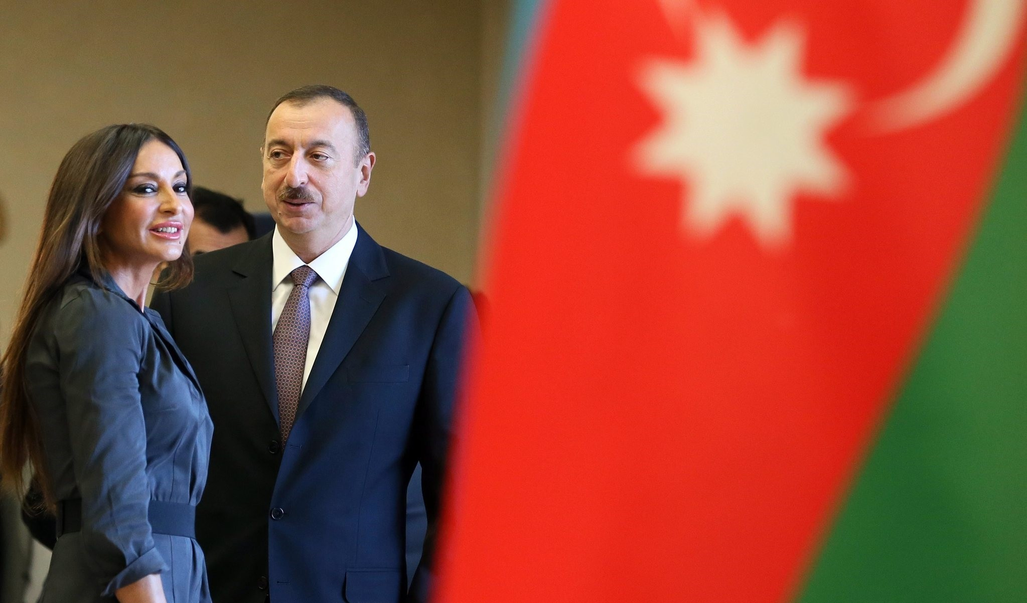 Azerbaijan's President Ilham Aliyev (C) looks at his wife Mehriban Aliyeva (L) as they pose for the media. (EPA Photo)