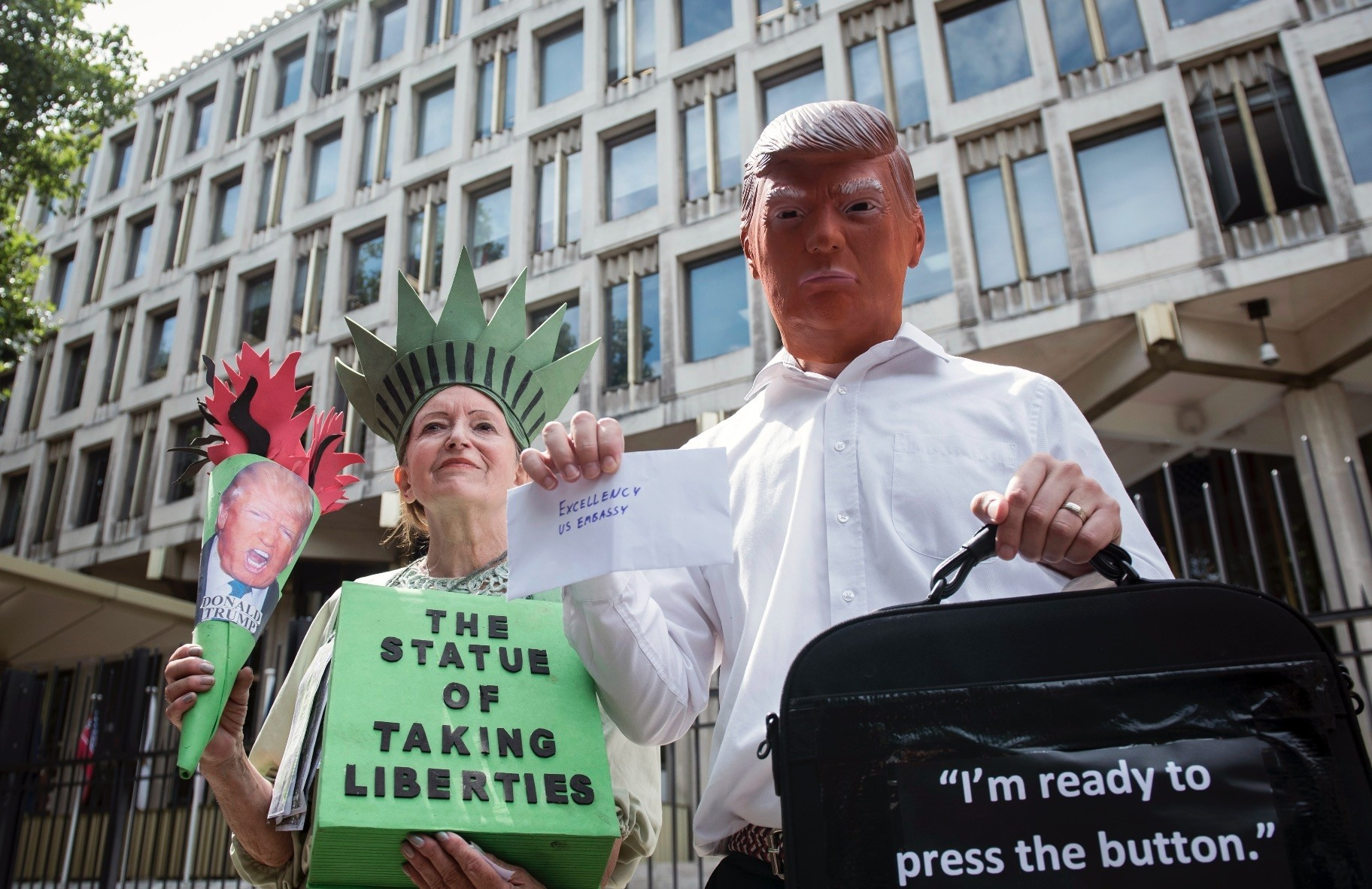 Campaigners take part in a protest against the nuclear tension between the U.S. and North Korea, outside the U.S. Embassy in Grosvenor Square, central London,  Aug. 11.