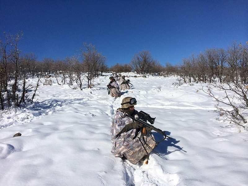 Turkish soldiers patrol the countryside in southeastern Turkey during anti-terror operations. (DHA File Photo)