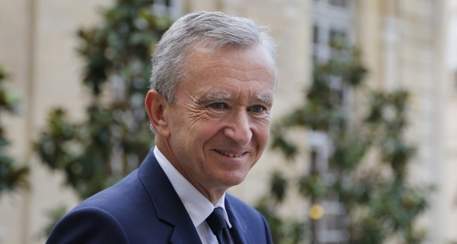 This photo taken on September 5, 2012 shows Luxury group LVMH CEO Bernard Arnault leaving the Matignon Hotel in Paris after a meeting. (AFP Photo)