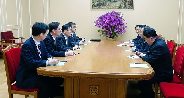 South Korean delegation (L row) talking with General Kim Yong Chol (2nd R), who is in charge of inter-Korean affairs for North Korea's ruling Workers' Party, during their meeting in Pyongyang on March 5, 2018.