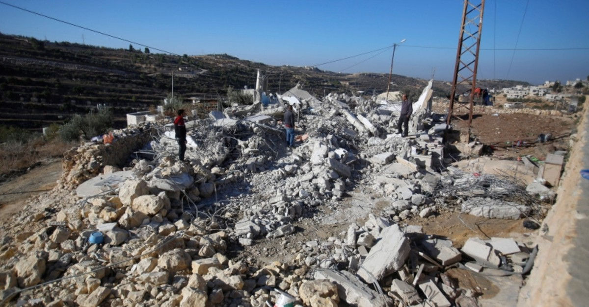 Palestinians looks at houses destroyed by the Israeli military in the village of Beit Kahil near the West Bank city of Ramallah, Thursday, Nov. 28, 2019.(AP Photo)