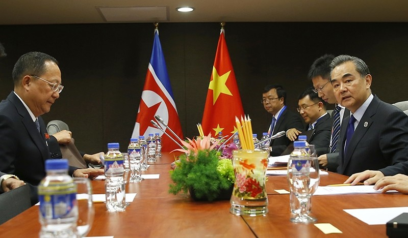 North Korean Foreign Minister Ri Yong Ho, left, prepares for a meeting with his Chinese counterpart Wang Yi, right, in the sidelines of the 50th ASEAN Foreign Ministers' Meeting (AP Photo)