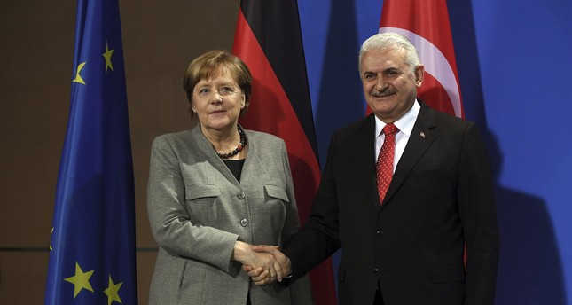 German Chancellor Merkel and Prime Minister Yıldırım shake hands during a press conference in the Chancellery, Berlin, Feb. 15.
