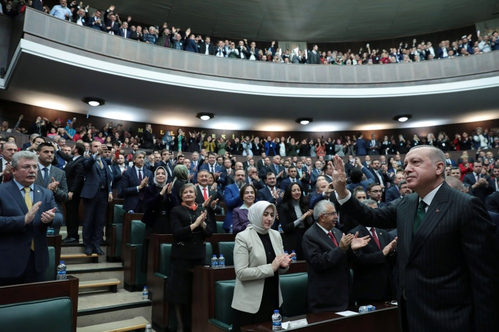 President Recep Tayyip Erdou011fan greets deputies from his ruling AK Party during a meeting in Parliament in Ankara, yesterday.