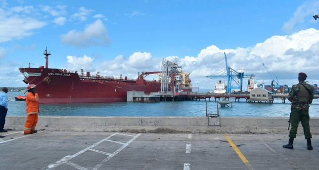 A security officer stands at the berth of an oil tanker carrying 200,000 barrels of crude oil worth Ksh 1.2 billion during the inaugural shipment of crude oil at Kipevu Oil Terminal in Kenya's port city of Mombasa Aug. 26, 2019. (AFP Photo)