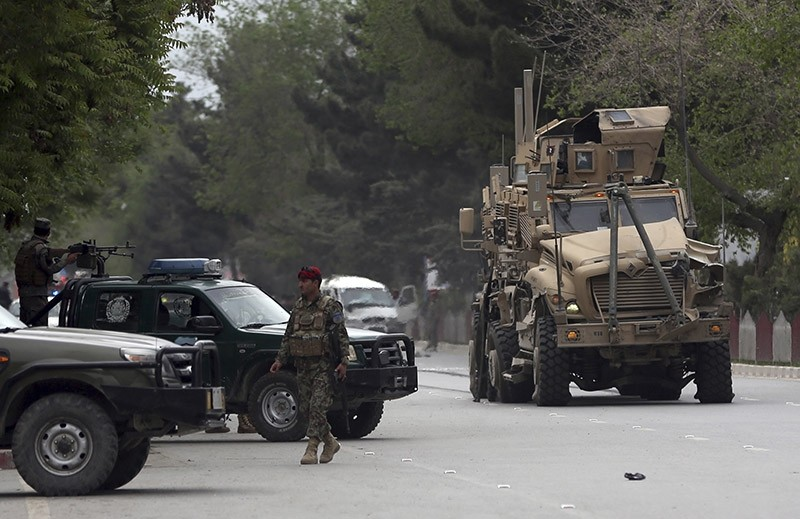 A damaged US military vehicle is being pulled near the site of a suicide attack in Kabul, Afghanistan, Wednesday, May 3 , 2017 (AP Photo)