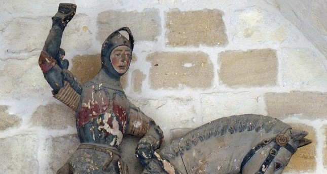 This undated handout photo released on Wednesday, June 27, 2018 shows the 16th-century wooden figure of St. George before it was restored, at St. Michael's Church in Estella, in northern Spain. (AP Photo)