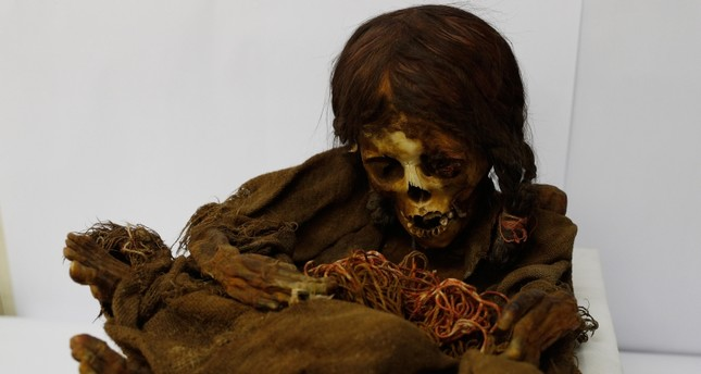 In this Aug. 15, 2019 photo, the 500-year-old mummy of an Incan girl sits inside a vault at the National Museum of Anthropology in La Paz, Bolivia (AP Photo)