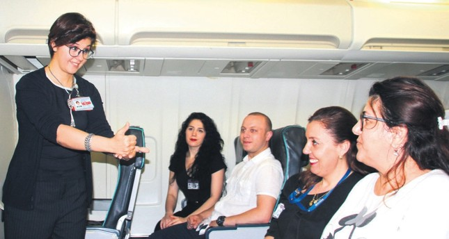 Flight attendants demonstrate their sign language skills.