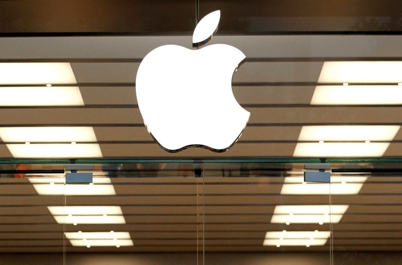 This Thursday, Sept. 19, 2013 file photo shows the Apple logo above a store location entrance in Dallas. (AP Photo)