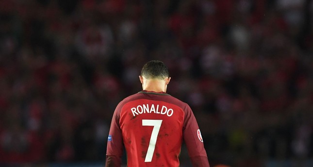 Portugal's forward Cristiano Ronaldo reacts after missing an opportunity on goal during the Euro 2016 group F football match between Portugal and Austria at the Parc des Princes in Paris on June 18, 2016. (AFP Photo)