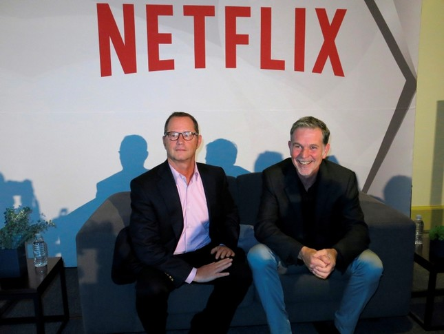 Reed Hastings, CEO and founder of Netflix, right, sits with Jonathan Friedland, global director of communications, as they pose for a portrait during a press conference about their three years of doing business in Latin America. (AP Photo)
