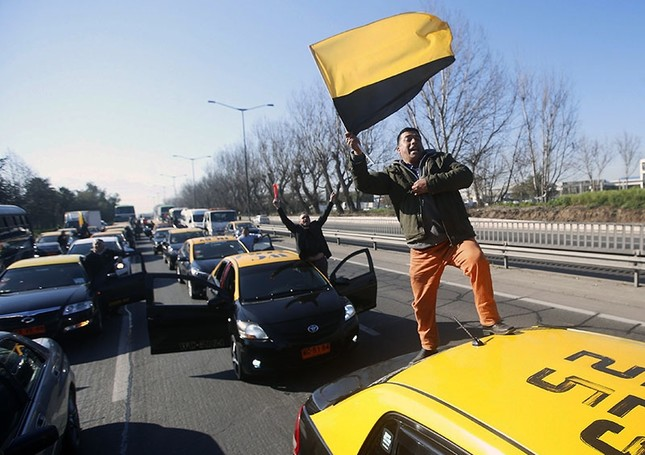 Taxi drivers block the access to the airport, during a protest in Santiago, Chile, 04 September 2017. (EPA Photo)