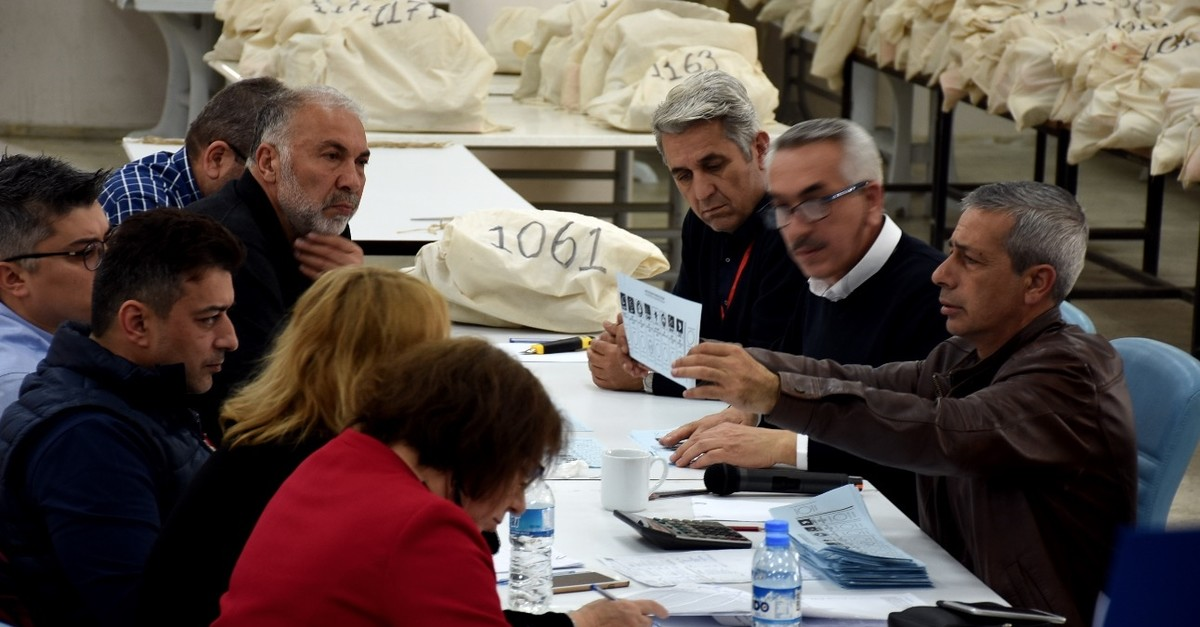 Representatives from various political parties and the YSK recount votes in the u015eiu015fli district of Istanbul, April 5, 2019.
