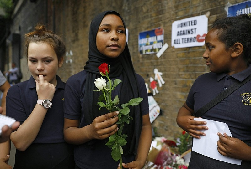 Muslim youth like this girl from north London's Pakeman Primary School may face questioning about their choice to wear a headscarf, following a newly-announced U.K. recommendation. (AFP Photo)