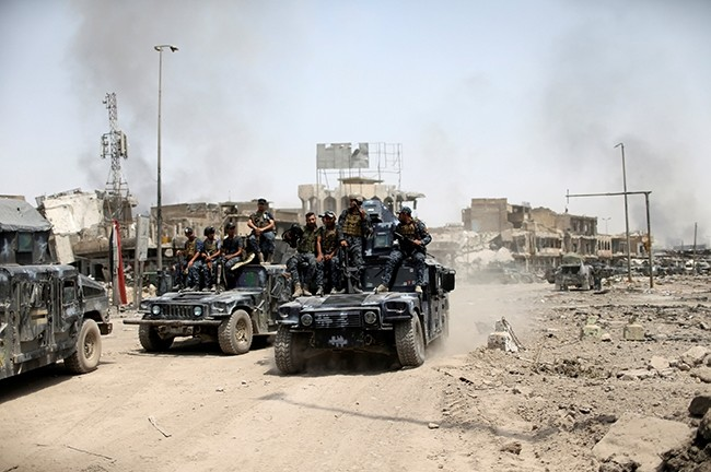 Iraqi Federal Police members ride in military vehicles during the fight with the Daesh militants in the Old City of Mosul, Iraq July 4, 2017. (Reuters Photo)