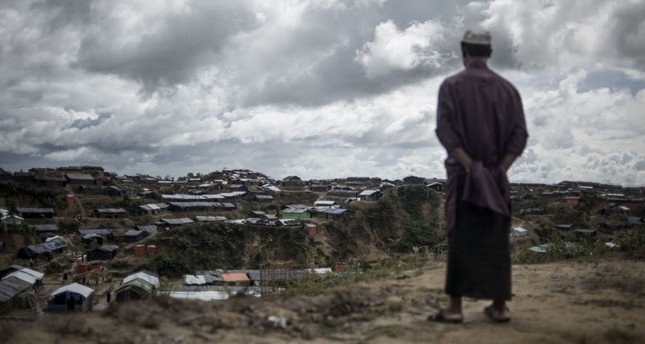 A Rohingya Muslim refugee looks on while standing in front of tents at the Balukhali refugee camp in Bangladesh's Ukhia district, Oct. 6.