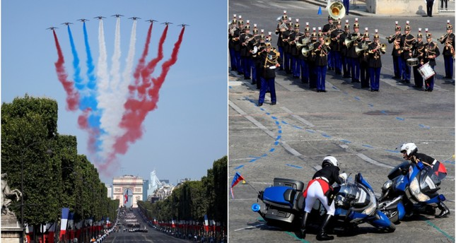 French Alphajets of the Patrouille de France fly over the Champs Elysees avenue as gendarmes right their motorcycles during the Bastille Day military parade after a fall in Paris, July 14, 2018. (REUTERS Photos)