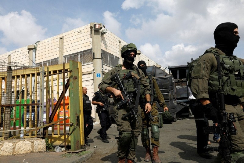 Israeli soldiers patrol near the scene where, according to Israeli media, a Palestinian shot and wounded three Israelis, at an industrial park adjacent to a Jewish settlement in the occupied West Bank October 7, 2018. (Reuters Photo)