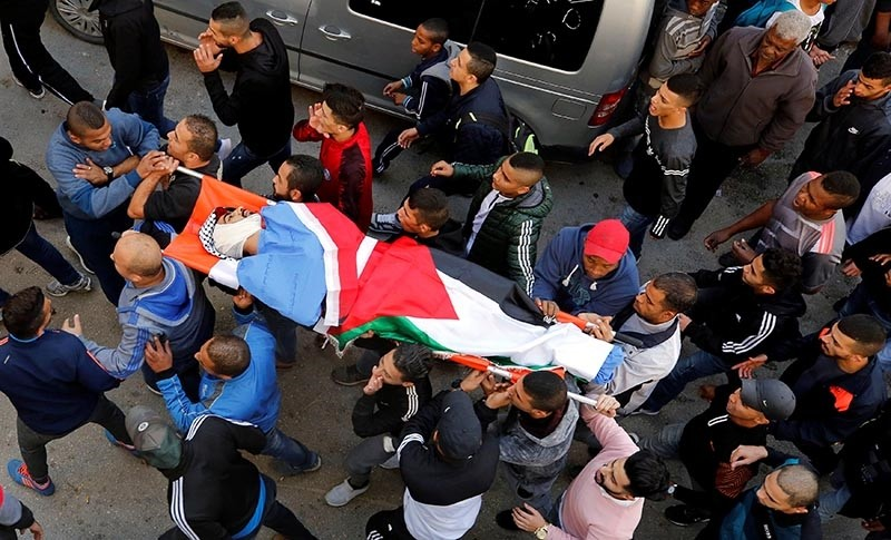 Mourners carry the body of Palestinian man Mohammed Habali during his funeral in Tulkarm refugee camp near Tulkarm in the occupied West Bank Dec. 4, 2018. (Reuters Photo)