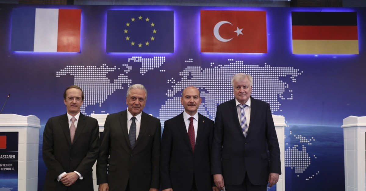 From L to R, Charles Fries, Franceu2019s envoy to Turkey, EU Commissioner for Migration Dimitris Avramopoulos, Interior Min. Su00fcleyman Soylu and German Interior Min. Horst Seehofer pose for photos following their news conference Ankara, Oct. 3, 2019.