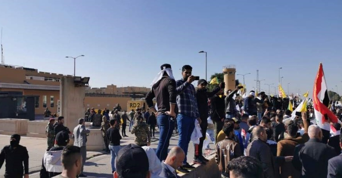 Protesters and militia fighters gather to condemn air strikes on bases belonging to Hashd al-Shaabi, outside the main gate of the U.S. Embassy in Baghdad, Iraq, Dec. 31, 2019. (Reuters Photo)