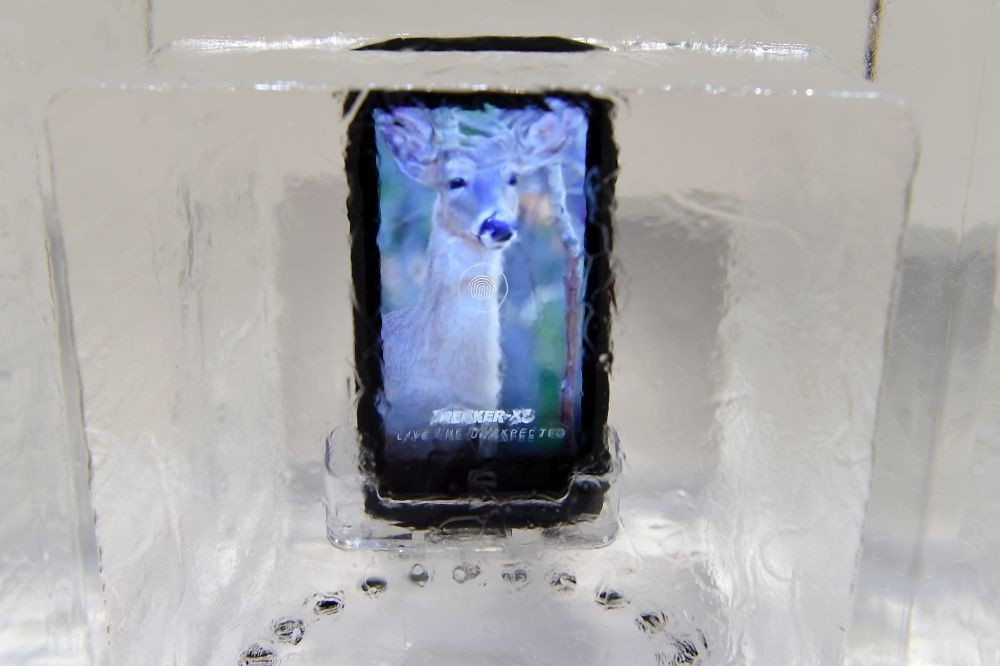 A Crosscall Trekker-X3 smartphone inside a block of ice on the first day of the Mobile World Congress in Barcelona.