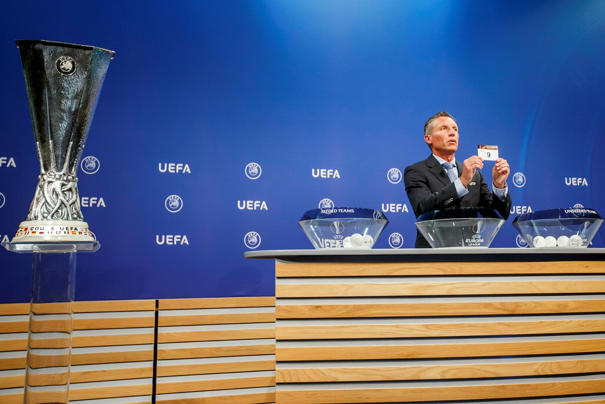 Michael Heselschwerdt, Head of Club Competition, holds a ticket with the number of group, during the drawing of games for UEFA Europa League 2017/18 First and First qualifying round, at UEFA headquarters in Nyon, Switzerland, 19 June 2017 (EPA Photo)