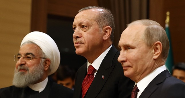 President Recep Tayyip Erdoğan (C) with Iran's Hassan Rouhani (L) and Russia's Vladimir Putin (AA Photo)