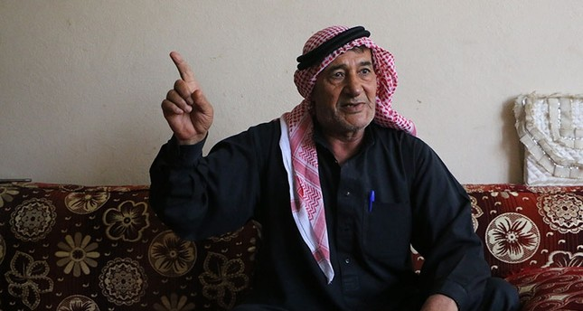 Halil Abbut, a 65-year-old of Arab origin, is one of those hundreds of people who were forced by the PYD to migrate to Akçakale, southern Turkey. (AA Photo)