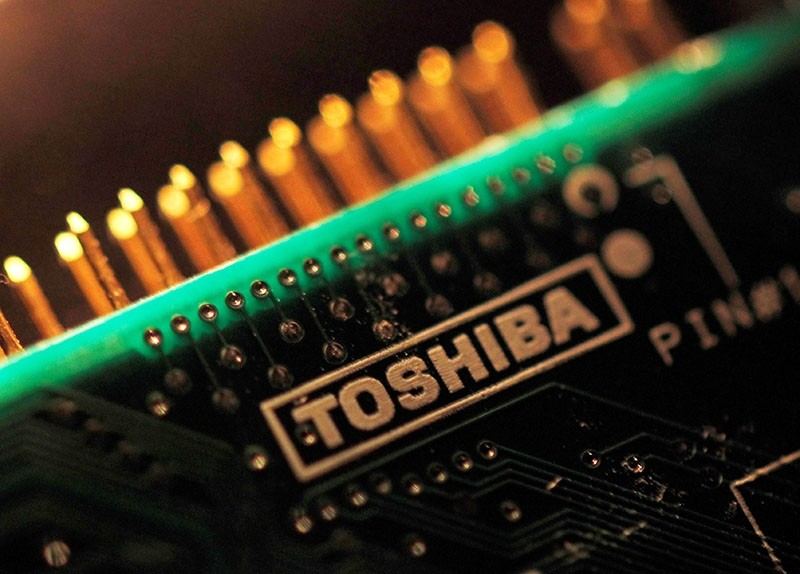 A logo of Toshiba Corp is seen on a printed circuit board in this photo illustration taken in Tokyo July 31, 2012. (Reuters Photo)