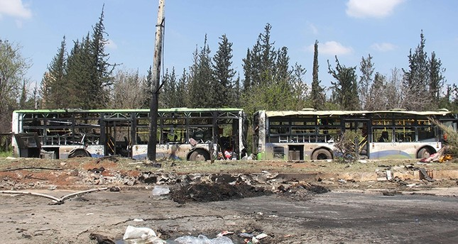 A picture taken on April 16, 2017, shows the damage a day after a suicide car bombing attack in Rashidin, west of Aleppo, targeted busses carrying Syrians evacuated from two besieged government-held towns of Fuaa and Kafraya AFP Photo