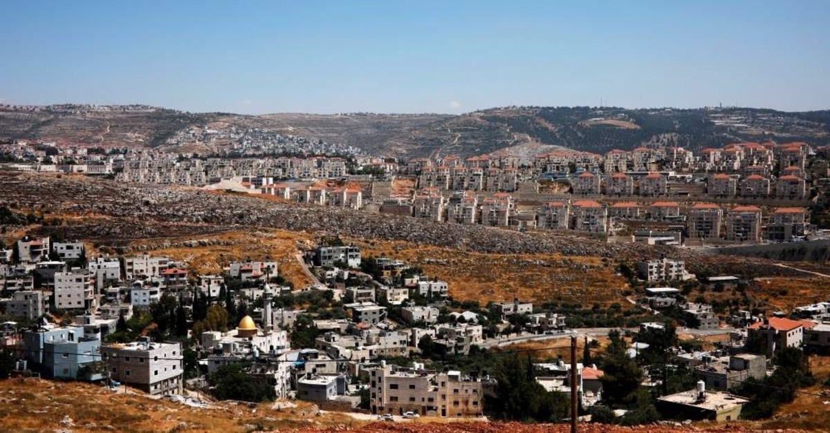 An aerial shot of Palestinian houses in the village of Wadi Fukin with the Israeli settlement of Beitar Illit in the background, the West Bank, June 19, 2019. (REUTERS Photo)