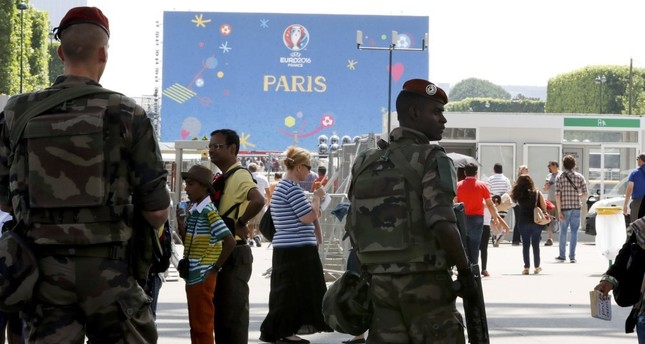 French military patrol at a fan zone near the Eiffel Tower before the start of the UEFA 2016 European Championship in Paris, France, June 7.