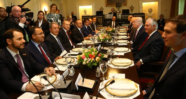Presidents Recep Tayyip Erdoğan, Donald Trump and their delegations prepare to have lunch in the Cabinet Room of the White House in Washington, May 16.