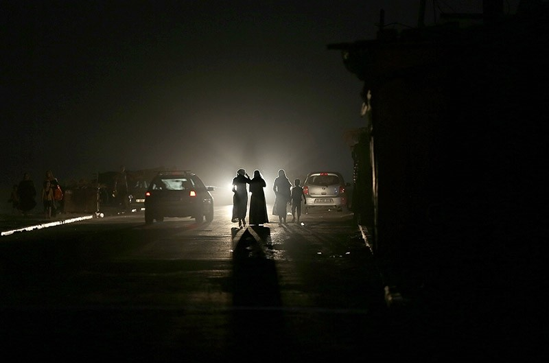 Palestinians walk in a street of the al Shateaa refugee camp during a power outage in Gaza City, Gaza Strip, 28 June 2017. (EPA Photo)