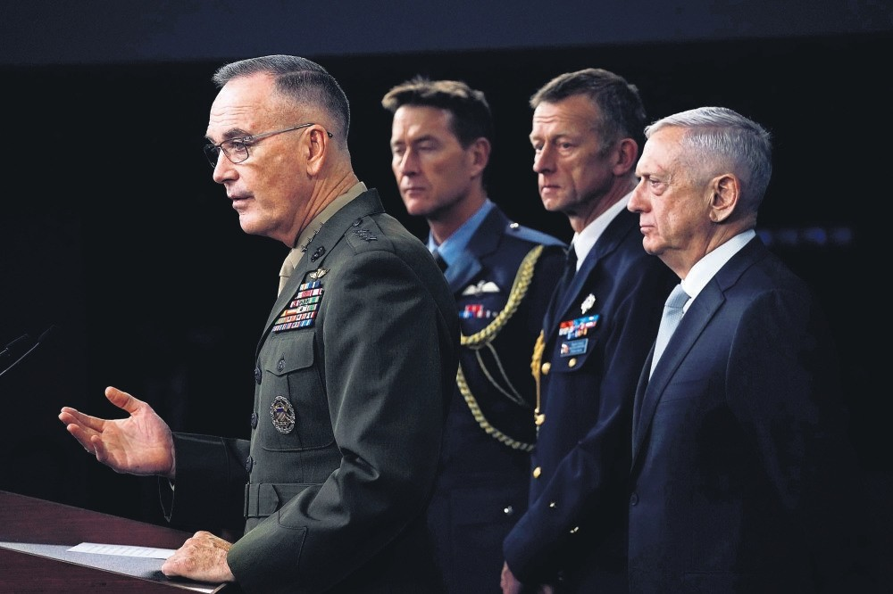 Chairmen of the Joint Chiefs of Staff Gen. Joseph Dunford (L) and U.S. Defence Secretary Jim Mattis (R) brief the media after U.S. President Donald Trump has ordered a joint force strike on Syria, April 13.