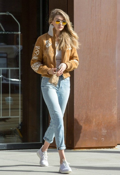 """American model Gigi Hadid is among today's famous """"It girls,"""" a word coined to describe stylish and socialite women."""