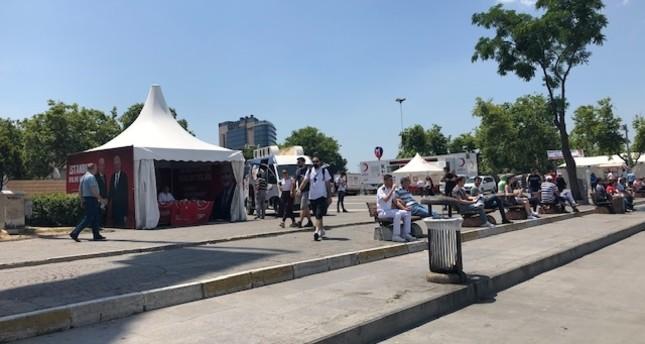 People walk through the campaign tents of AK Party metropolitan mayoral candidate Binali Yıldırım in Kadıköy, July 14.