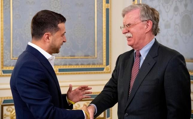 John Bolton, US National Security Advisor, right, is welcomed Ukrainian President Volodymyr Zelenskiy in Kyiv, Ukraine, Wednesday, Aug. 28, 2019. (Ukrainian Presidential Press Office via AP)
