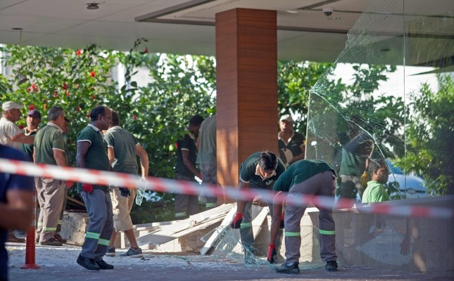 Workers at Acapulco Hotel in Kyrenia (Girne) in the Turkish Republic of Northern Cyprus assess the damage after the building was damaged when a military depot exploded nearby, on September 12, 2019. (AFP Photo)