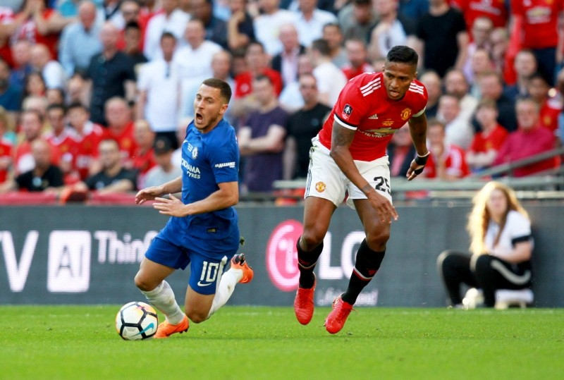 Chelsea's Edan Hazard and  Manchesters Antonio Valencia (R) in action during the FA Cup final match Chelsea vs Manchester United. (EPA Photo)