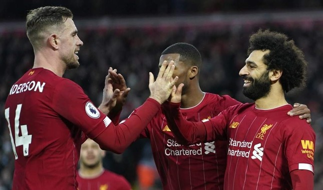 Liverpool players celebrate a goal during an English Premier League match against Southampton at Anfield Stadium, Feb. 1, 2020. AP Photo
