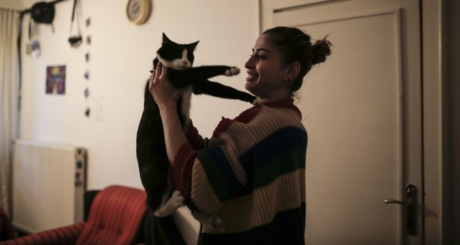 Özge Kara spends her nights at home playing with her cats and knitting.