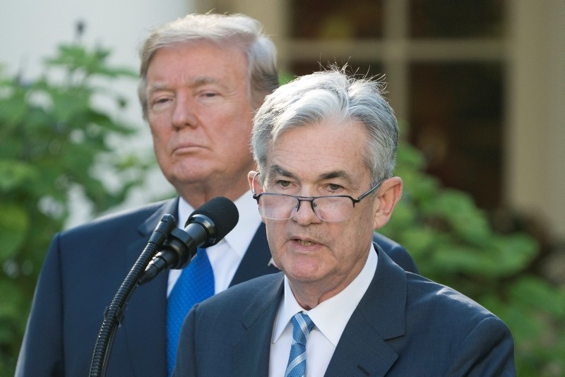 Fed chief Jerome Powell (R) delivers remarks while Trump (L) listens (EPA Photo)