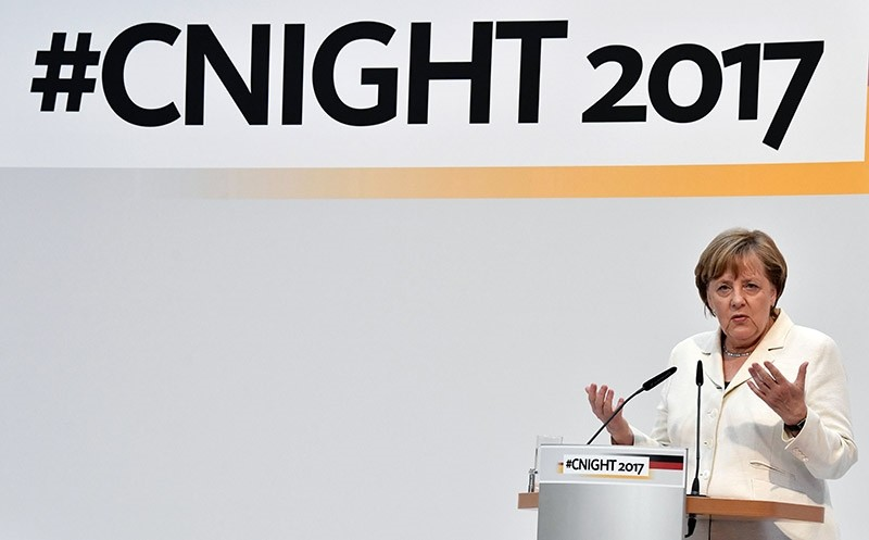 German Chancellor Angela Merkel addresses guests at the #cnight event (AFP Photo)